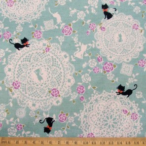 Lacey Cats cotton fabric in teal, from Kokka