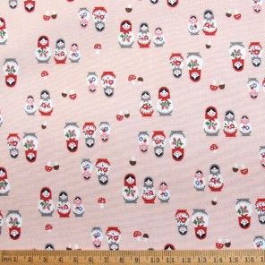 Russian Dolls cotton fabric in salmon pink