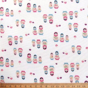 Russian Dolls cotton fabric on off-white